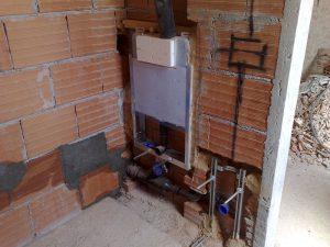 Posa della casseta del WC e installazione delle staffe per i sanitari